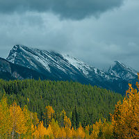 Peaks of the Canadian Rockies tower above fall colors.