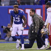 Odel Beckham Jr, New York Giants, throws his helmet at the end of thew game after failing to hold on to an Eli Manning pass late in the game during the New York Giants V San Francisco 49ers, NFL American Football match at MetLife Stadium, East Rutherford, NJ, USA. 16th November 2014. Photo Tim Clayton