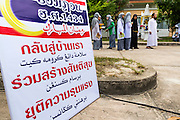 07 JULY 2013 - NARATHIWAT, NARATHIWAT, THAILAND:  Thai Muslims wait to get into a civic affairs projected by the Royal Thai Marines. Royal Thai Marines in Narathiwat province held a special ceremony Sunday in advance of Ramadan. They presented widows, orphans and indigent people with extra rice and food as a part of the Thai government's outreach to resolve the Muslim insurgency that has wracked southern Thailand since 2004. The Holy Month of Ramadan starts on about July 9 this year. Muslims are expected to fast from dawn to dusk, engage in extra prayers, recitation of the Quran and perform extra acts of charity during Ramadan. It is the holiest month of the year for Muslims.   PHOTO BY JACK KURTZ