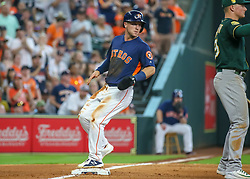 April 29, 2018 - Houston, TX, U.S. - HOUSTON, TX - APRIL 29:  Houston Astros third baseman Alex Bregman (2) gets to third base on a throwing error by Oakland Athletics catcher Jonathan Lucroy (21) in the bottom of the seventh inning during the baseball game between the Oakland Athletics and Houston Astros on April 29, 2018 at Minute Maid Park in Houston, Texas.  (Photo by Leslie Plaza Johnson/Icon Sportswire) (Credit Image: © Leslie Plaza Johnson/Icon SMI via ZUMA Press)