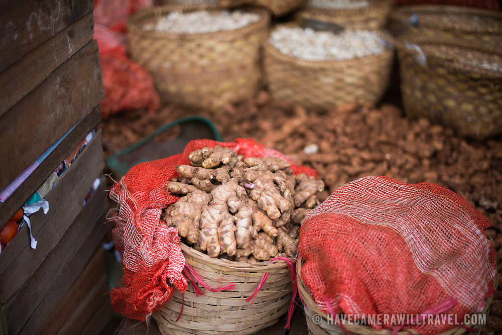 Baskets of ginger root at the fish and flower market in Mandalay, Myanmar (Burma).