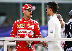 November 26, 2017 - Abu Dhabi, United Arab Emirates - Motorsports: FIA Formula One World Championship 2017, Grand Prix of Abu Dhabi, ..#5 Sebastian Vettel (GER, Scuderia Ferrari), #94 Pascal Wehrlein (GER, Sauber F1 Team) (Credit Image: © Hoch Zwei via ZUMA Wire)
