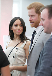 Meghan Markle looks at Prince Harry during a reception for delegates from the Commonwealth Youth Forum at the Queen Elizabeth II Conference Centre, London, during the Commonwealth Heads of Government Meeting.