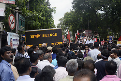 July 4, 2017 - Kolkata, West Bengal, India - Left Front holds a rally at College Street to protest against State Government decision to impose ban on procession and protest at College Street on July 4, 2017 in Kolkata, India. (Credit Image: © Saikat Paul/Pacific Press via ZUMA Wire)