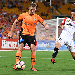 BRISBANE, AUSTRALIA - DECEMBER 22: Luke DeVere of the Roar kicks the ball under pressure from Jumpei Kusukami of the Wanderers during the round 4 Foxtel National Youth League match between the Brisbane Roar and Melbourne City at AJ Kelly Field on December 22, 2016 in Brisbane, Australia. (Photo by Patrick Kearney/Brisbane Roar)