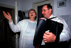 CZECH REPUBLIC MORAVIA BANOV APR98 - Tetka Zobakovich gestures while singing with Jiri Chovanec during his visit to her home during Easter 98.  During Easter, folklore dress, music and mutual visits are part of the customary traditional celebrations in Moravia.  jre/Photo by Jiri Rezac<br /> <br /> © Jiri Rezac 1998<br /> <br /> Tel:   +44 (0) 7050 110 417<br /> Email: info@jirirezac.com<br /> Web:   www.jirirezac.com