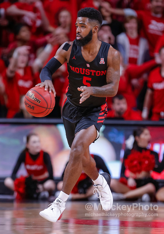 CINCINNATI, OH - MARCH 10: Corey Davis Jr. #5 of the Houston Cougars brings the ball up court during the game against the Cincinnati Bearcats at Fifth Third Arena on March 10, 2019 in Cincinnati, Ohio. (Photo by Michael Hickey/Getty Images) *** Local Caption *** Corey Davis Jr.