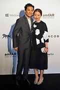 HONG KONG - MARCH 14:  Singer and actor Alex To (L) and his wife Ice Lee (R) arrive on the red carpet during the 2015 amfAR Hong Kong gala at Shaw Studios on March 14, 2015 in Hong Kong. Photo : Lucas Schifres/Abaca  (Photo by Lucas Schifres/Lucas Schifres)