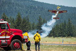 July 8, 2017 - Truckee, California, U.S - Squaw Valley firefighters watch KIRBY CHAMBLISS perform aerial stunts in his Edge 540 airplane during the .Truckee Tahoe Air Show and Family Festival at the Truckee Tahoe Airport (elevation 5901 ft.) two miles east of Truckee, California, on Saturday, July 8, 2017. The Air Show is funded and presented by the Truckee Tahoe Airport District...Participating airplanes and pilots include:.P-51, pilot Ken Gottschall.Alpha Jet, pilot Mark Peterson.T-6, pilot Barry Hancock.BF9-2 Biplane, pilot Danny Sorensen.Cessna 206/Launch Jump Plane.Firecat L-39, pilot Rich Perkins.Edge 540 & Red Bull Air Force Wingnuts, pilot Kirby Chambliss.Phenom 300, pilot Erik Pilegaard (Credit Image: © Tracy Barbutes via ZUMA Wire)
