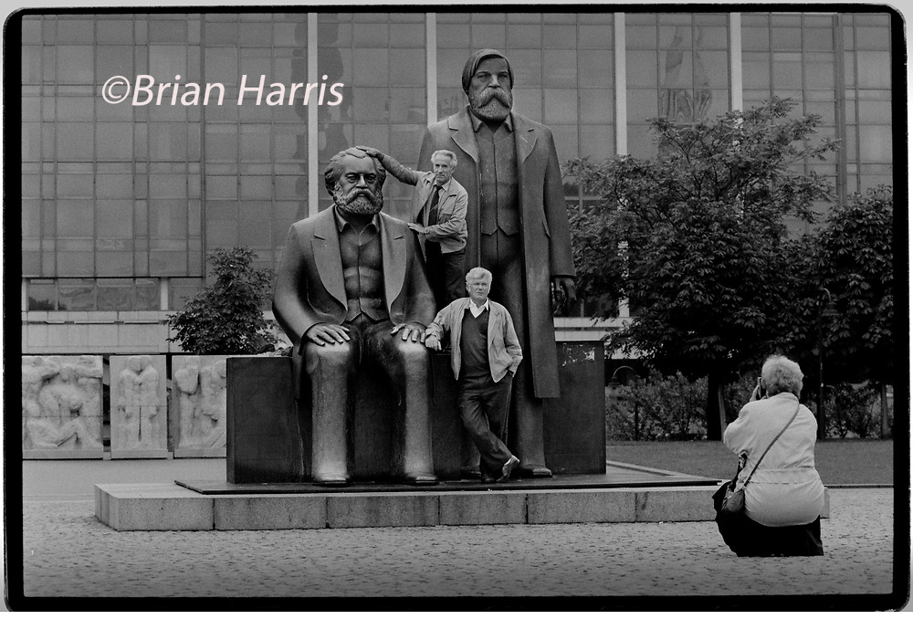 Berlin_Statue of Marx and Engels 1994. Berlin. Marx-Engels-Forum is a public park in the central Mitte district of Berlin, the capital of Germany. It is named for Karl Marx and Friedrich Engels, authors of The Communist Manifesto of 1848 and regarded as two of the most influential people in the socialist movement. The park was created by the authorities of the former German Democratic Republic (GDR) in 1986