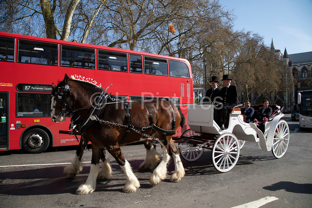 Dignitaries in a horse drawn carriage in London, England, United Kingdom.