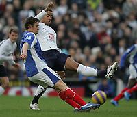 Photo: Lee Earle.<br /> Portsmouth v Tottenham Hotspur. The Barclays Premiership. 01/01/2007. Tottenham's Tom Huddlestone (R) tackles Sean Davis.