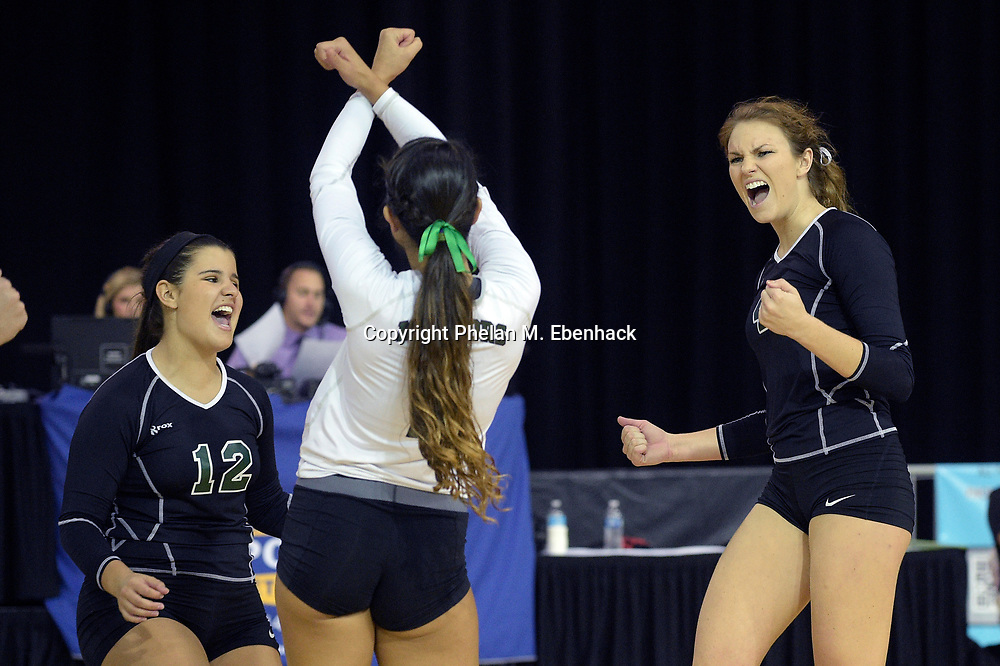Jupiter's Cassi DePasquale (12), Dani Jaffe, center, and Cara Guthrie, right, celebrate a point during the first set of the championship match against Manatee at the FHSAA State Volleyball Finals in Kissimmee, Fla., Saturday, Nov. 15, 2014. (Photo by Phelan M. Ebenhack)