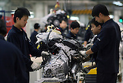 Chinese workers build a BMW engine in in a BMW factory in Shenyang. The German luxury auto maker expects its vehicle sales in China to hit 22 thousand units in 2005, including imports. Last year (2004), BMW posted a 16 percent fall in vehicle sales in China to 15 thousand units, including imports. BMW makes its luxury sedans in China with local partner Brilliance China Automotive Holdings Limited.
