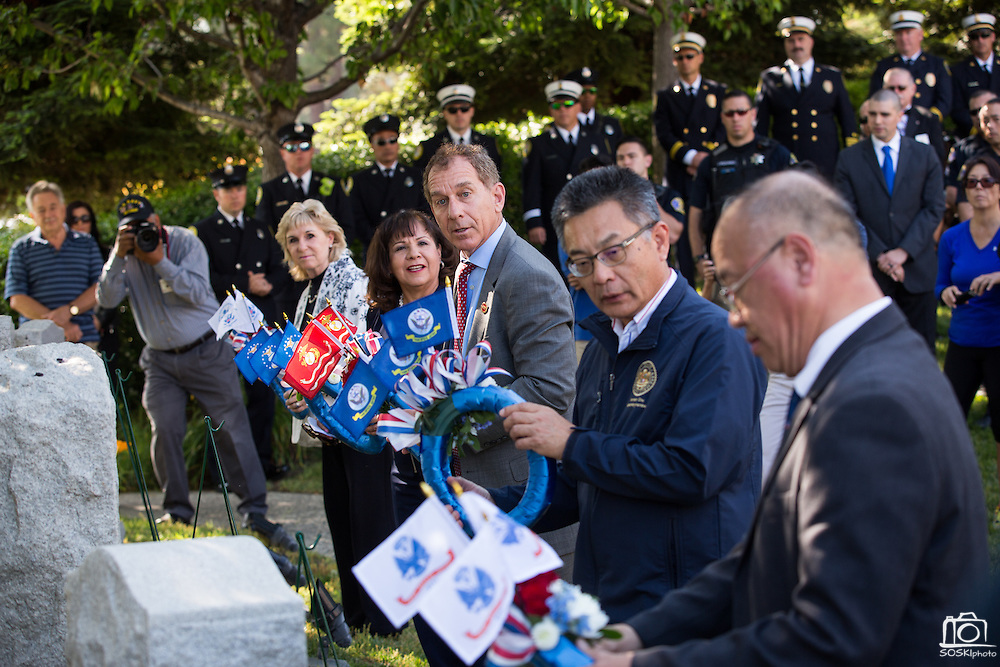 Milpitas City Council lay wreaths alongside war memorials during the Wreath Presentation during the City of Milpitas Memorial Day ceremony at Milpitas City Hall in Milpitas, California, on May 30, 2016. (Stan Olszewski/SOSKIphoto)