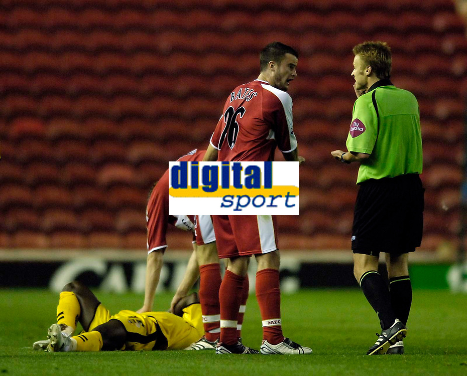Photo: Jed Wee.<br /> Middlesbrough v Notts County. Carling Cup. 20/09/2006.<br /> <br /> Middlesbrough's Matthew Bates protests his innocence to referee M Jones after they played on with Notts County's Tcham N'Toya-Zoa lay injured.