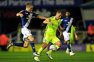 Steve Sidwell of Brighton & Hove Albion (R) in action with Maikel Kieftenbeld of Birmingham City challenging. <br /> Sky Bet Football League Championship match, Birmingham City v Brighton & Hove Albion at St.Andrew's Stadium in Birmingham, the Midlands on Tuesday 5th April 2016.<br /> Pic by Ian Smith, Andrew Orchard Sports Photography.