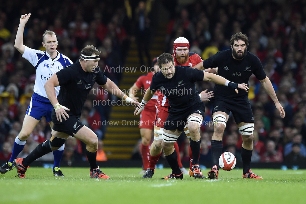Richie McCaw of NZ © looks to pounce on the loose ball. Dove Men Series 2014, Wales v New Zealand , autumn international rugby match at the Millennium Stadium in Cardiff, South Wales on Saturday 22nd November 2014<br /> pic by Andrew Orchard, Andrew Orchard sports photography.
