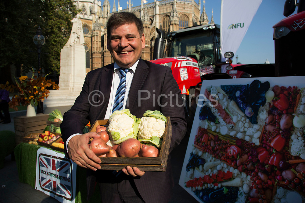 Andrew Bridgen MP at the National Farmers Union NFU took machinery, produce, farmers and staff to Westminster to encourage Members of Parliament to back British farming, post Brexit on 14th September 2016 in London, United Kingdom. MPs were encouraged to sign the NFU's pledge and wear a British wheat and wool pin badge to show their support.
