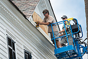 Workers attach hurricane shutters to a historic home along the Charleston Battery in preparation for approaching Hurricane Florence September 11, 2018 in Charleston, South Carolina. Florence, a category 4 storm, is expected to hit the coast between South and North Carolina and could be the strongest storm on record for the East Coast of the United States.