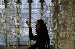 (c) Licensed to London News Pictures 22/05/212.A thousand cast glass bells evoking a visual quality of water will be suspended in the nave of St MaryÕs Church, York, this spring. .'The Temple of a Thousand Bells', by Laura Bel?m, is inspired by an ancient legend about a temple on an island that sinks into the ocean. As the story unfolds it reveals the attempts of a sailor to hear the music of the thousand bells which were lost to the depths. .The installation will open on May 25 and is free entry. .The glass bells used in the installation have all been individually produced at the Glassblobbery, Wales, and will hang with nylon strings in the nave of the former church. They do not have a clapper, creating a visual metaphor that matches the narrated legend, which tells about the lost music of the bells in the depths of the ocean.  Pictured is Julie Redpath of York Museum Trust..Photo credit : Sam Atkins/LNP