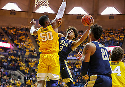 Dec 8, 2018; Morgantown, WV, USA; Pittsburgh Panthers guard Malik Ellison (3) drives in the lane defended by West Virginia Mountaineers forward Sagaba Konate (50) during the first half at WVU Coliseum. Mandatory Credit: Ben Queen-USA TODAY Sports