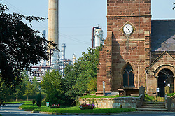 St Marys church Thornton Le Moors village. Stanlow Oil refinery in background. Ellesmere Port, Cheshire