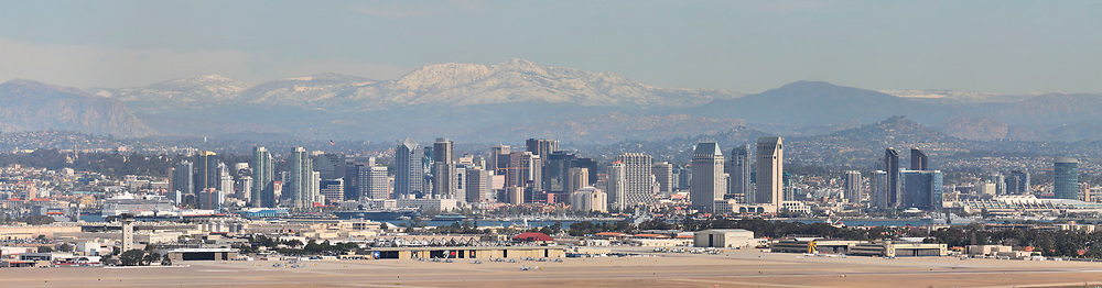 North Island Naval Air Station in foreground, Balboa Park and El Capitan Mountain on the left, Convention Center on the far right.