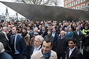 London Wednesday 17th April 2013. The funeral of former Prime Minister Baroness Margaret Thatcher. Members of the public look on in their hundreds from next to St Paul's information centre.