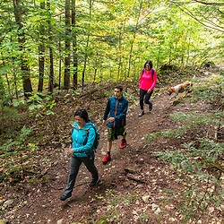 Hikers in the Raymond Community Forest in Raymond, Maine. Fall.