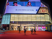 20 MAY 2015 - BANGKOK, THAILAND:  People leave EmQuartier, a new high end mall in Bangkok. Bangkok's malls consume more electricity than some provinces. Siam Paragon, a popular high end mall in central Bangkok, consumes nearly twice as much electricity at the northern province of Mae Hong Son. Thais and foreigners alike flock to the malls in Bangkok, which are air conditioned. Most of the electricity consumed in Bangkok is generated in Laos and Myanmar. In 2013, the Bangkok Metropolitan Region consumed about 40 per cent of the Thailand's electricity, even though the BMR is only 1.5 per cent of the country's land area and about 22 per cent of its population.    PHOTO BY JACK KURTZ
