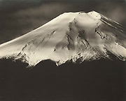 """Okada Koyo<br /> Fresh Snow (from Oshino)<br /> Date: 1940s<br /> <br /> Description: Detailed graphic study of the cone of Mount Fuji, taken in the 1940s. This same photo was published in """"Mt. Fuji"""", by Okada Koyo, Hobundo Publishing, Tokyo, 1964, plate number 92. In this book, the caption reads:<br /> <br /> """"Fresh Snow (from Oshino). On a clear morning, Fuji always seems to be in excellent spirits. Today, she is a happy woman with powdered face and laughing lips. In this photo, I used the shadow of the clouds to emphasize the whiteness of the peak"""".<br /> <br /> Vintage or near vintage, double weight, gelatin silver print, with smooth semi-matte surface, unsigned.<br /> <br /> Condition: Very good with deep rich tones, this is a stunning print. The print comes matted in an archival mat board.<br /> <br /> Size: 10 1/4 in. x 8 1/4 in. (260 mm x 210 mm).<br /> <br /> Price: ¥175,000 JPY<br /> <br /> <br /> <br /> <br /> <br /> <br /> <br /> <br /> <br /> <br /> <br /> <br /> <br /> <br /> <br /> <br /> <br /> <br /> <br /> <br /> <br /> <br /> <br /> <br /> <br /> <br /> <br /> <br /> <br /> <br /> <br /> <br /> <br /> <br /> <br /> <br /> <br /> <br /> <br /> <br /> <br /> <br /> <br /> <br /> <br /> <br /> <br /> <br /> <br /> <br /> <br /> <br /> <br /> <br /> <br /> <br /> <br /> <br /> <br /> <br /> <br /> <br /> <br /> <br /> <br /> <br /> <br /> <br /> <br /> <br /> <br /> <br /> <br /> <br /> <br /> <br /> <br /> <br /> <br /> <br /> <br /> <br /> ."""