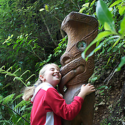 A maori carving gets a good luck kiss and cuddle at Happy Valley Adventures, Cable Bay Rd. Nelson New Zealand, 30th January  2011, Photo Tim Clayton.