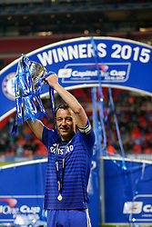 Goalscorer John Terry of Chelsea holds up the trophy as he celebrates after winning the Capital One Cup Final - Photo mandatory by-line: Rogan Thomson/JMP - 07966 386802 - 01/03/2015 - SPORT - FOOTBALL - London, England - Wembley Stadium - Chelsea v Tottenham Hotspur - Capital One Cup Final.
