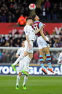 Swansea's Federico Fernandez (l) challenges Aston Villa's Rudy Gestede for a header. Barclays Premier league match, Swansea city v Aston Villa at the Liberty Stadium in Swansea, South Wales on Saturday 19th March 2016.<br /> pic by  Carl Robertson, Andrew Orchard sports photography.