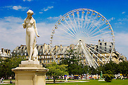 Paris - France -Jardin des Tuileries - Statue with carousel behind .<br /> <br /> Visit our FRANCE HISTORIC PLACES PHOTO COLLECTIONS for more photos to download or buy as wall art prints https://funkystock.photoshelter.com/gallery-collection/Pictures-Images-of-France-Photos-of-French-Historic-Landmark-Sites/C0000pDRcOaIqj8E