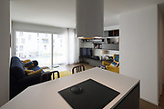 Open space. Detail of kitchen with a view of the living room. Nobdy inside