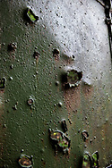 Doors punctured by shrapnel at Battery Way on Corregidor Island. Battery Way was the location of four 12-inch mortars that fired at Japanese positions on Bataan in the final week of the battle that ended in the American surrender of Corregidor to the Japanese on May 6, 1942.
