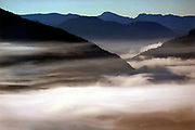 Low hanging fog drifting in and out of the mountains (Beaufort Range) overlooking Pt. Alberni on Vancouver Island. (Steve Ringman / The Seattle Times, 2002)