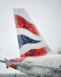 SAT PIC © under license to London News Pictures. 18.12.2010. BA planes lie covered in snow. Heathrow airport in London is not excepting arrivals today (Sun) and will only be handling a handful of departures. Ice and snow have closed the airport and caused travel disruption around most of the UK Photo Credit should read Stephen Simpson/London News Pictures