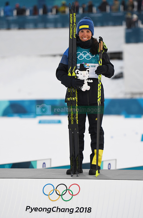 PYEONGCHANG, Feb. 10, 2018  Sweden's Charlotte Kalla reacts on the podium during the victory ceremony of Ladies' 7.5km + 7.5km Skiathlon of Cross-Country Skiing at the 2018 PyeongChang Winter Olympic Games at the Alpensia Cross-Country Skiing Centre in PyeongChang, South Korea, on Feb. 10, 2018. Charlotte Kalla won the gold medal by 40:44.9. (Credit Image: © Lui Siu Wai/Xinhua via ZUMA Wire)