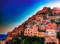 """""""The colors burst while the evening fades over Positano""""...<br /> <br /> Taking an evening stroll along the strada of Positano, the sun reflected off the hillside forcing the colorful villas to pose just one more time. All indications seemed to verify that late May in Positano presented a spectacular pallet of every color under God's rainbow. This quaint seaside village stimulated one's senses, aggrandizing its chest and boasting specular perfection. I cannot imagine a more benevolent time of year than during late spring to visit the bellissimo Amalfi coast. This image was one of my last of the evening before a long hike up to the terrace of Hotel Montemare's famous restaurant. Finally, time to relax and unwind while admiring yet another truly breathtaking sea view of <br /> Positano Bay and the colorful village above."""