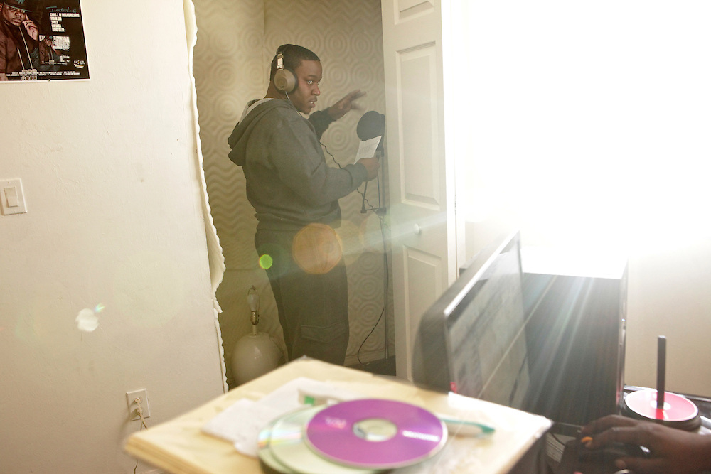 "TimWes records the song ""Unborn Child ? originally by the late rapper, Tupac Shakur ? in the closet studio of producer Dang Dizzle. Dizzle's studio is a room he rents from his sister-in-law in Lehigh Acres, Fla. TimWes, who is expecting his first child, calls himself Mr. ReceiptMoney, meaning he makes his money the legal way. ""I'm in my own lane. I'm not competing,"" he said comparing himself to other rappers. ""I'm the only one talkin' bout legal money."""