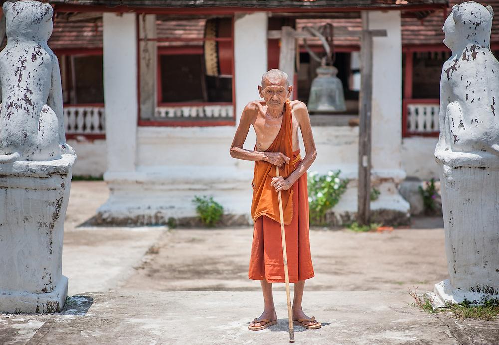 Old skinny monk in Luang Prabang temple