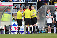 Referee Brendan Malone (l) debating with his staff on whether or not to award the goal to Lyle Taylor of AFC Wimbledon. Skybet football league two match, Wycombe Wanderers  v AFC Wimbledon at Adams Park  in High Wycombe, Buckinghamshire on Saturday 2nd April 2016.<br /> pic by John Patrick Fletcher, Andrew Orchard sports photography.