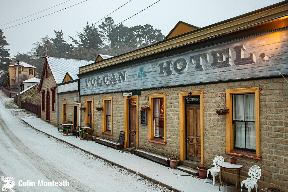 Vulcan Hotel, historic pub from goldfields era , during winter snow storm, St Bathans, Central Otago, New Zealand.