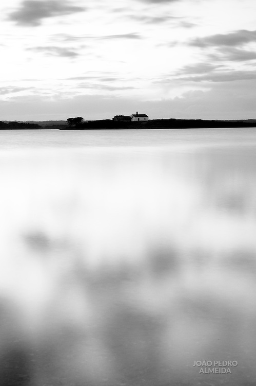 Isolated house in the middle of the artificial lake of Alqueva dam