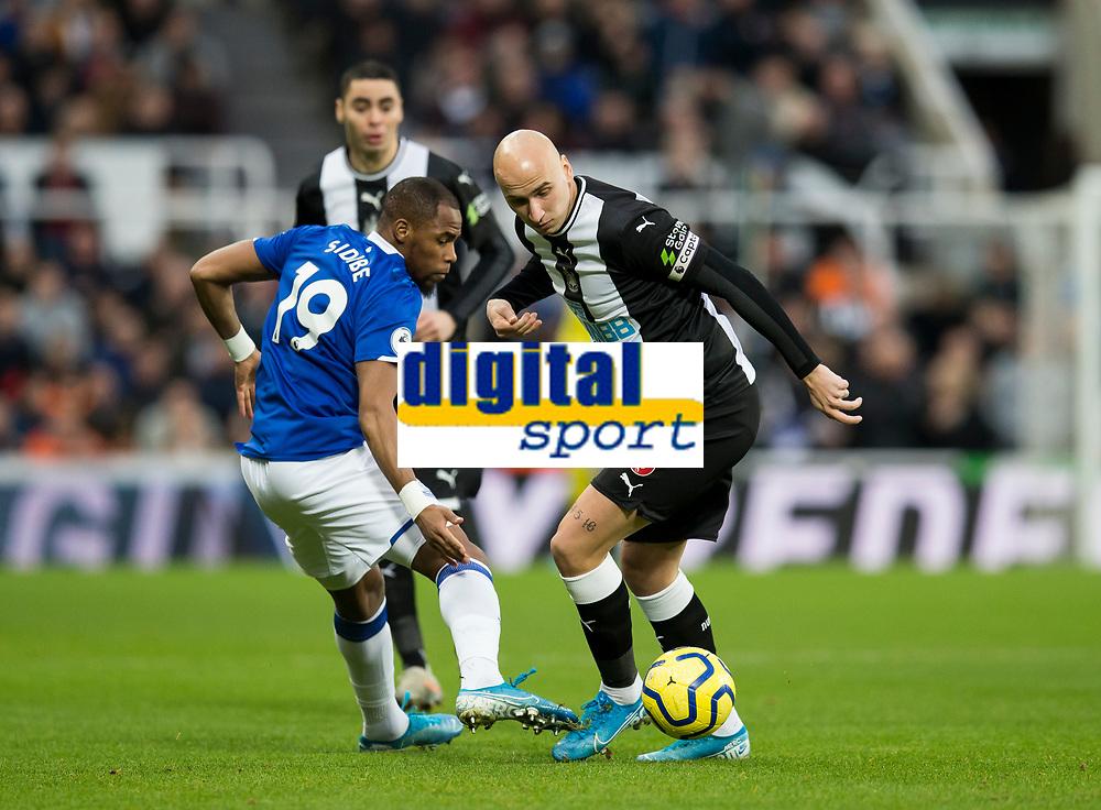 Football - 2019 / 2020 Premier League - Newcastle United vs. Everton<br /> <br /> Jonjo Shelvey of Newcastle United vies with Djibril Sidibe of Everton, at St James' Park Stadium.<br /> <br /> COLORSPORT/BRUCE WHITE