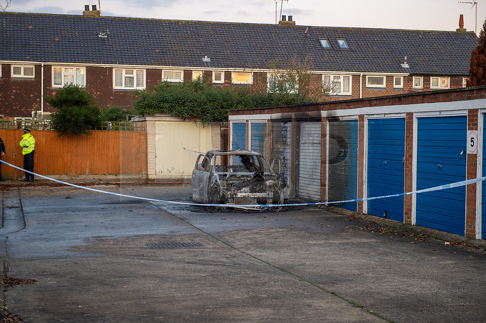 © Licensed to London News Pictures. 20/11/2019. Ilford, UK. A burnt out vehicle inside a crime scene after a teenager has been stabbed to death in Ilford. Police were called at 22:20hrs on Tuesday, 19 November to Fullwell Avenue, Ilford, following reports of a fight outside Owen Waters House. Officers attended and found a 19-year-old man suffering from stab injuries. Police administered first aid before paramedics from the London Ambulance Service arrived. However despite their best efforts, the victim died at the scene. Photo credit: Peter Manning/LNP