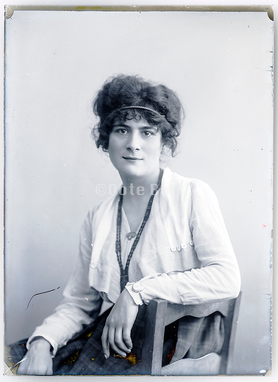 woman sitting for a casual portrait France ca 1920s